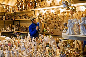 a woodcarver at a German Christmas market