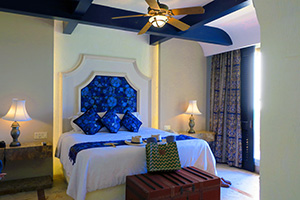 a bedroom at a Mayan riviera resorts all inclusive