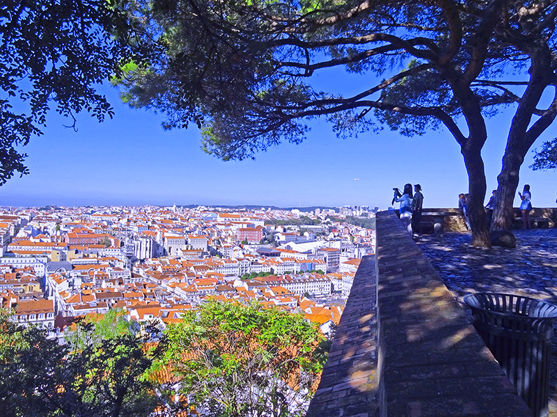 people looking out over a city, one of the things to do in Lisbon