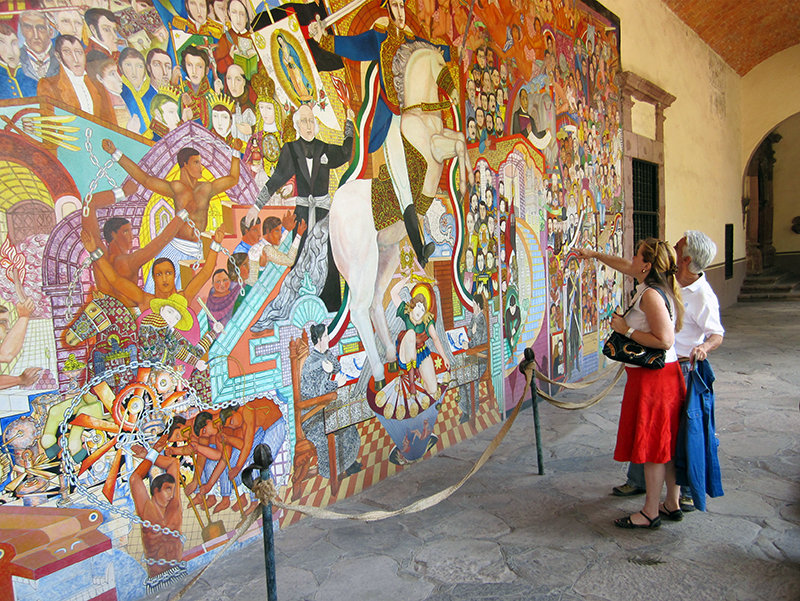 couple travel - couple looking at a mural