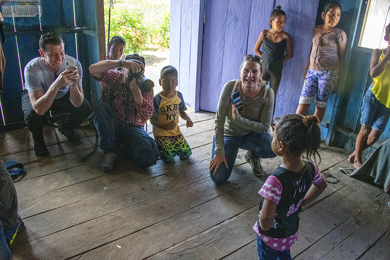 people with schoolcbildren while on our luxury Amazon River cruise