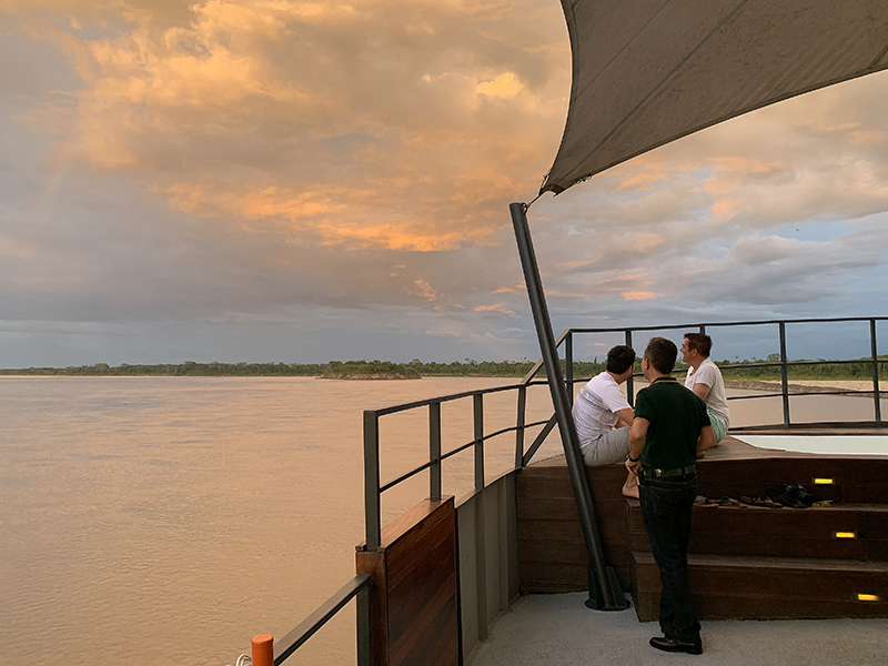 sunset on our luxury Amazon River cruise in Peru