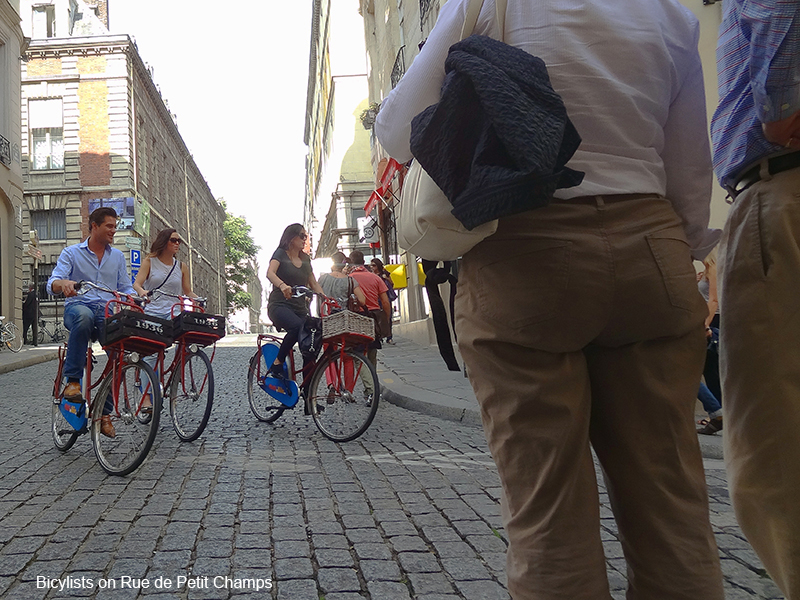 people on bicycles in photos of Paris