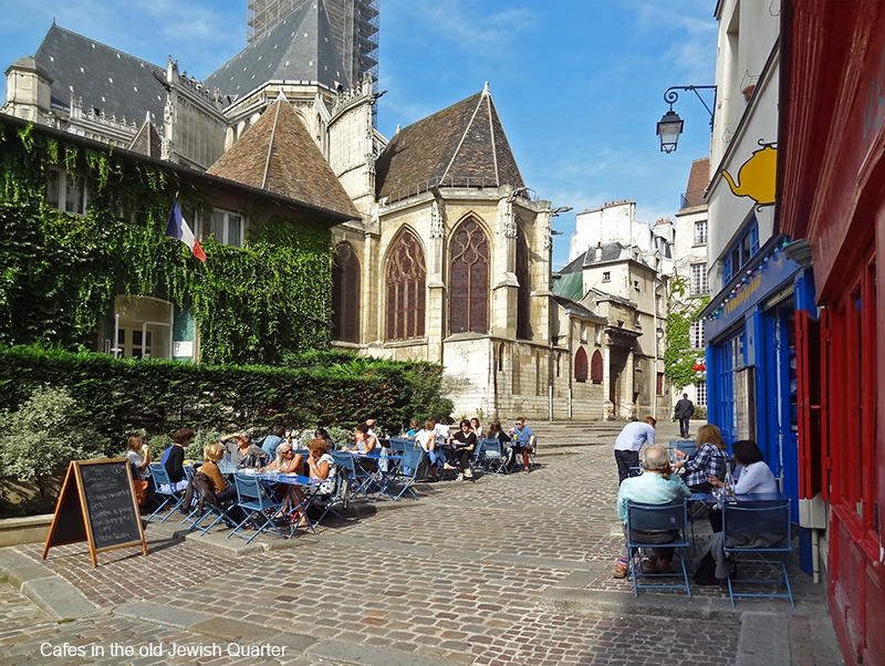 people in cafes in photos of Paris