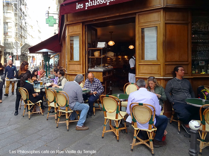 people in a cafe in photos of Paris