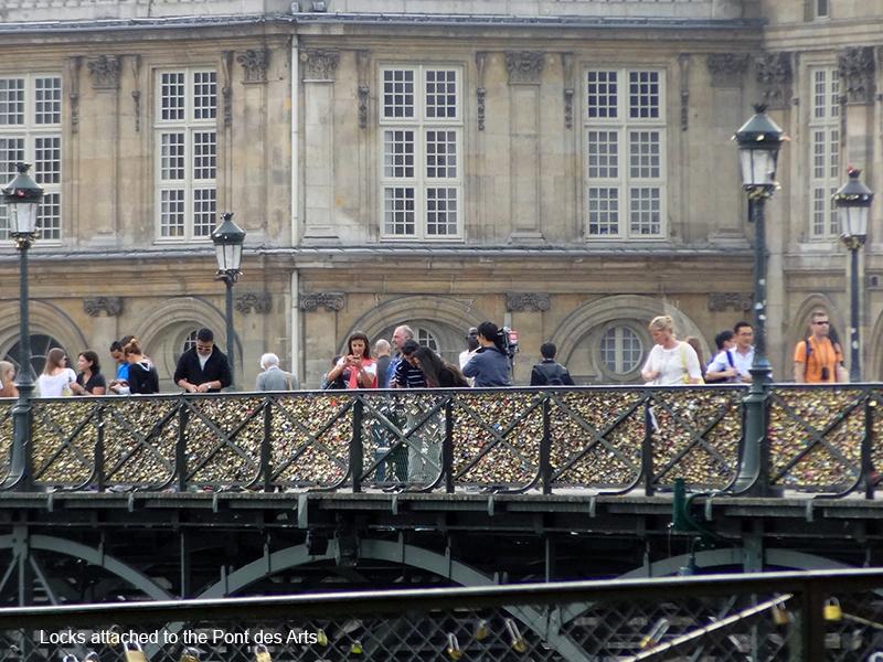 people on a bridge in photos of Paris