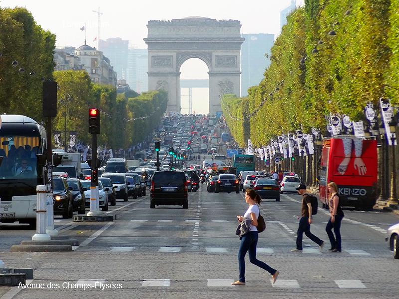 woman cross a street in photos of Paris