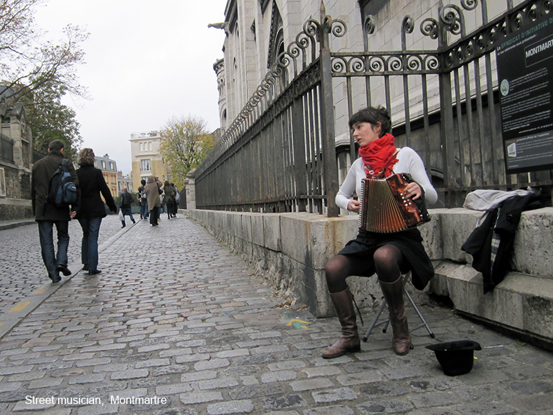 a street musician in photos of Paris