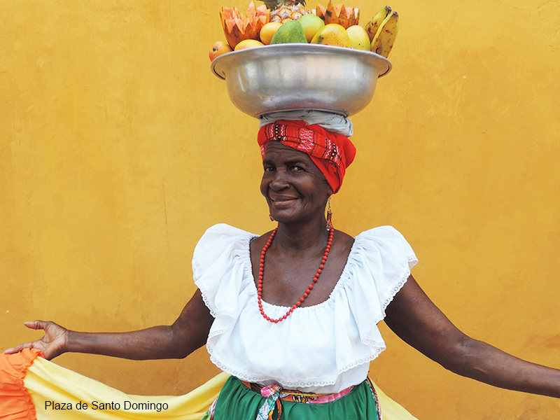 Photos of Cartagena Colombia - a woman with fruit on her head