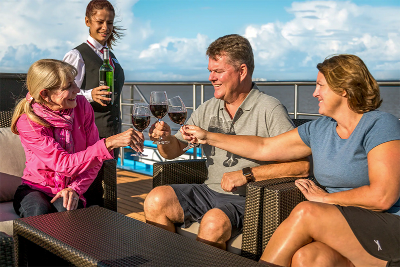 people having a wine on a luxury river cruise