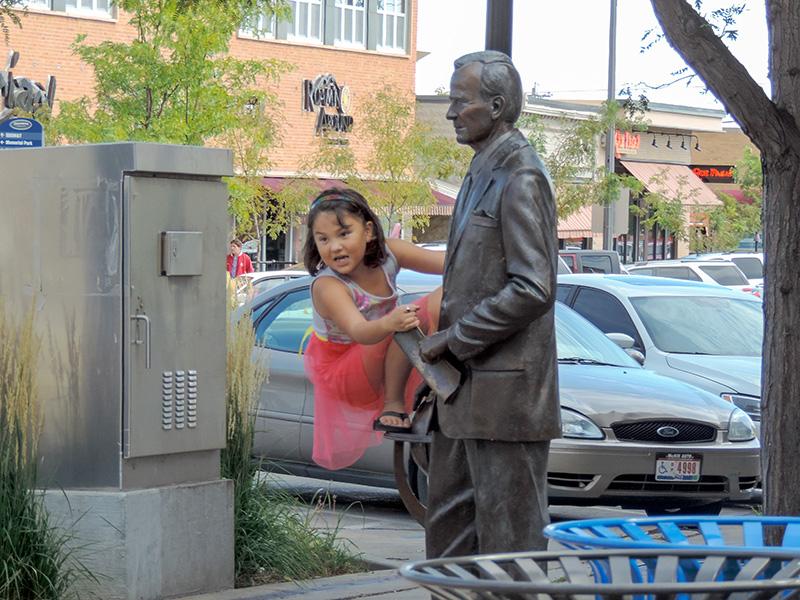 girl on a statue - South Dakota road trip