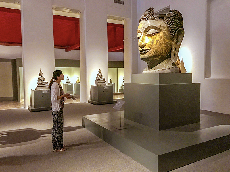 people in the national museum , one of the things to do in Bangkok