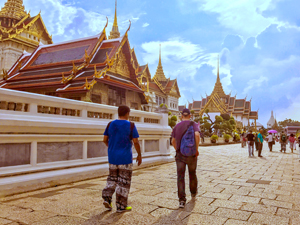 people walking by the Grand Palace, one of the things to do in Bangkok