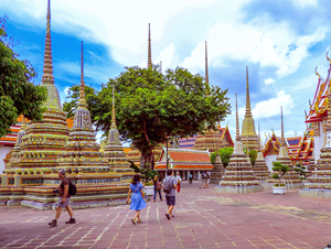 people admiring stupas, one of the things to do in Bangkok