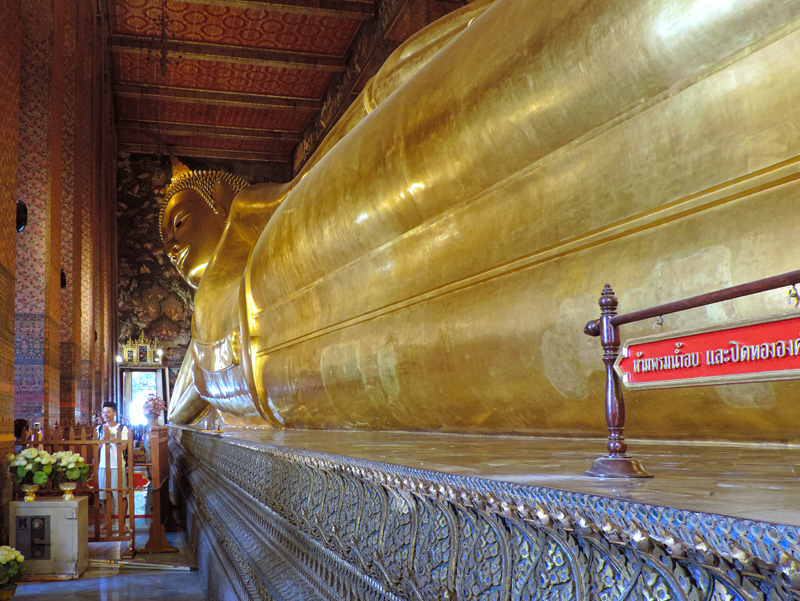 people by a huge Buddha, one of the things to do in Bangkok