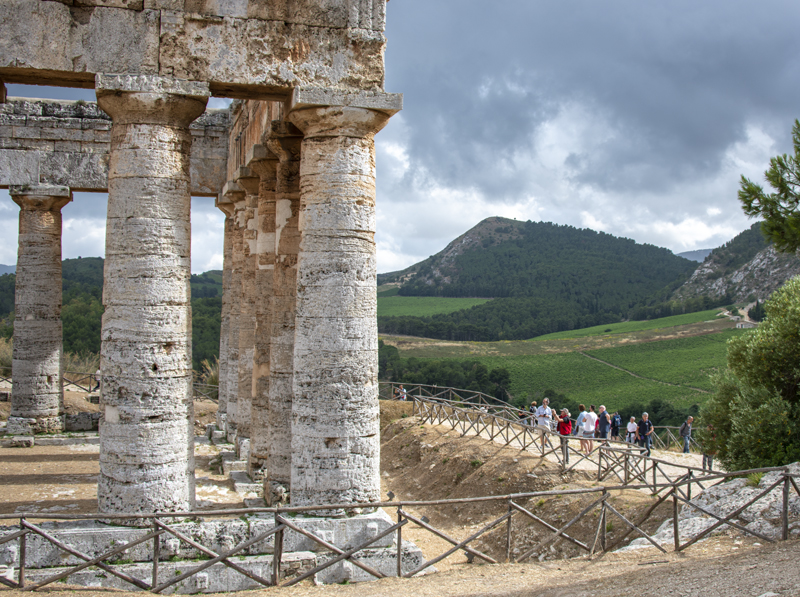an ancient Greek temple by wineries in sicily