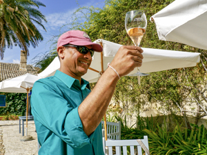 a man toasting with a glass of wine