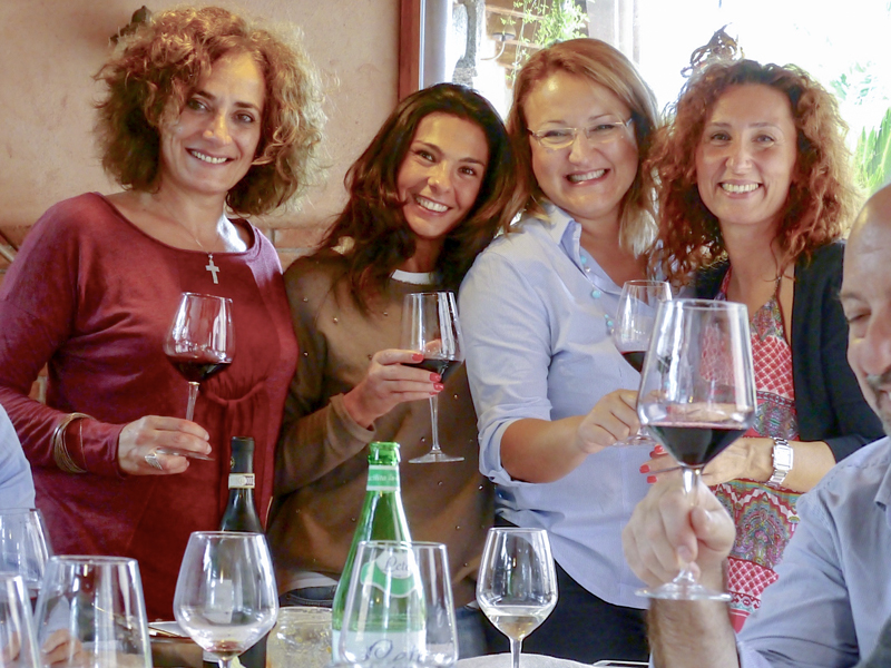 young woman visiting wineries in sicily