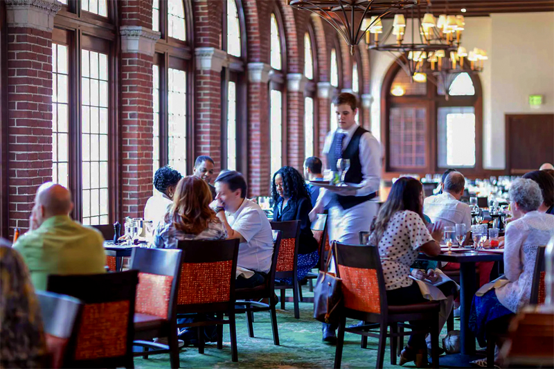 a waiter in a busy restaurant in teh Hudson Valley