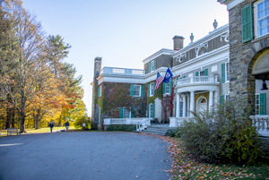 People by a large mansion in the Hudson Vally