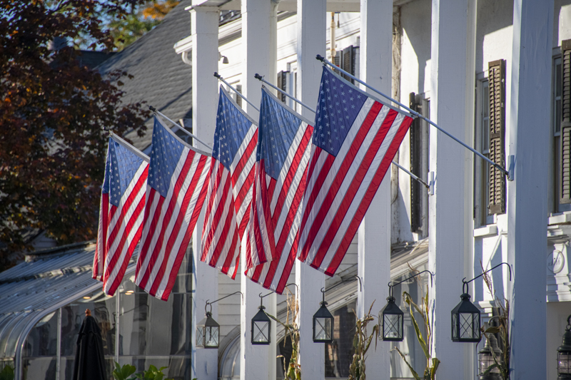 flags outside a large building in the Hudson Valley