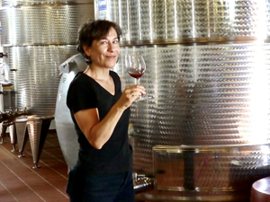 a woman with a glas of wine at wineries in sicily