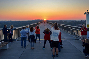 people taking photos of the sunrise