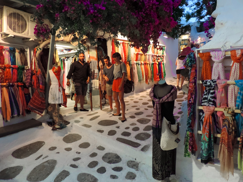 people outside a colorful boutique in Mykonos Town