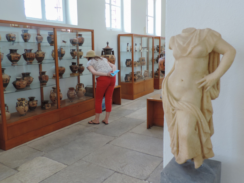 woman in red pants in a museum