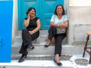 two women on steps in Mykonos Town