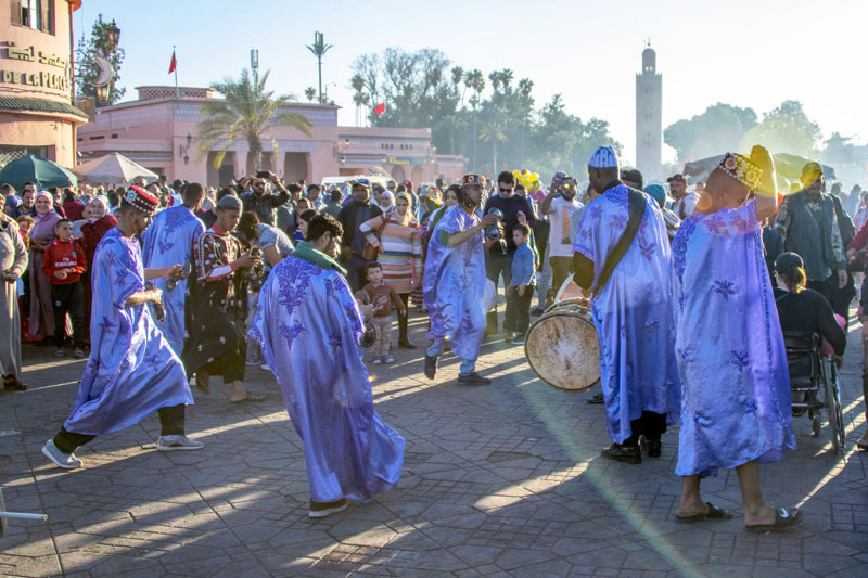 watching performers in the Jemma-el-Fna, one of the things to do in Marrakesh