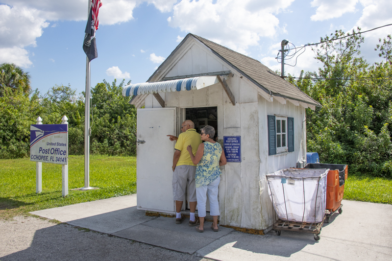 people visiting the smallest post office in the U.S. on a Florida Gulf Coast road trip