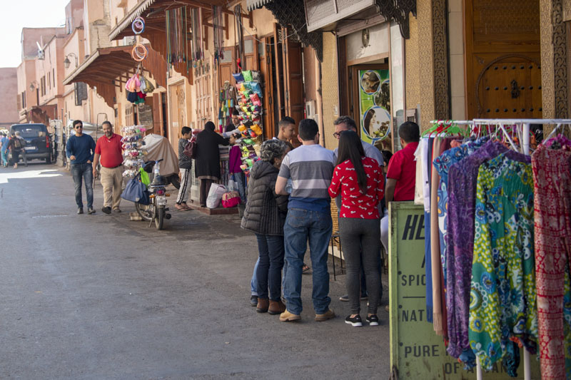 people on a street talking