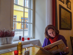 woman looking at a restaurant menu