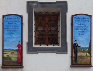 a window with two blue signs