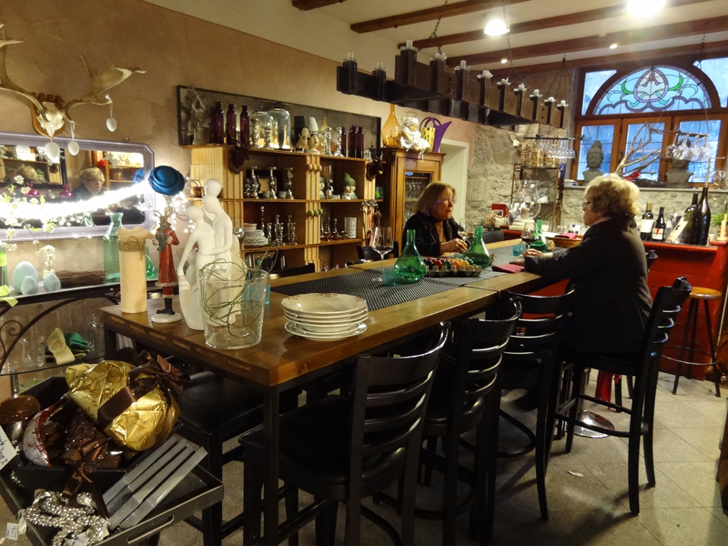 women at a table in a Fussen boutique