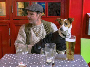 a man and his dog at a pub on Ireland's west coast