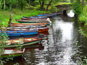 boats in a stream on Ireland's west coast