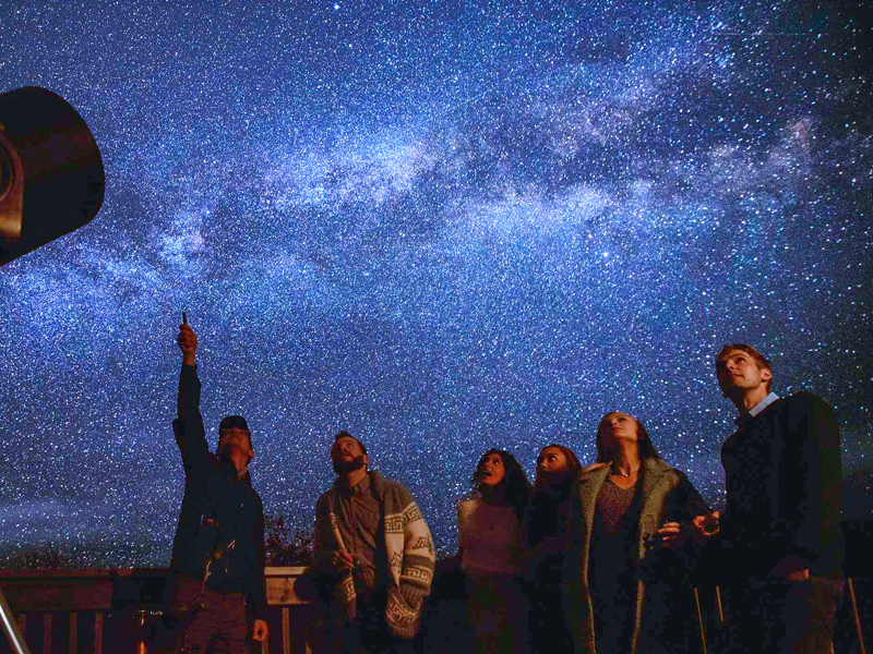 people viewing the stars with a guide