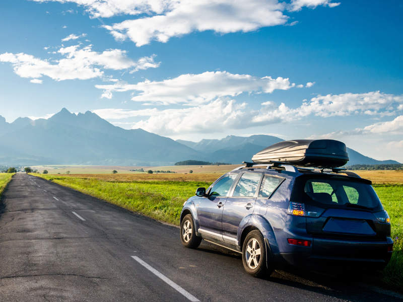 a car driving towards a mountain on a best road trip