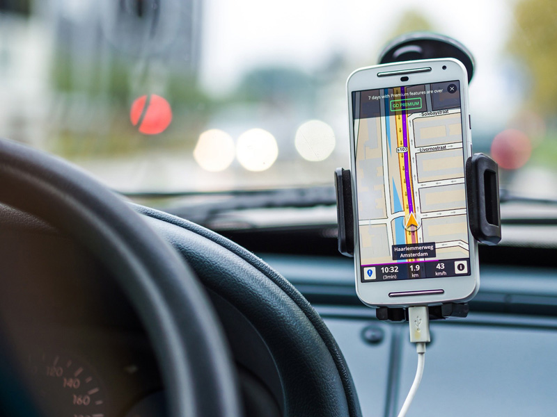 A mobile phone showing directions on a best road trip