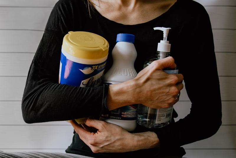 woman holding supplies for a best road trip