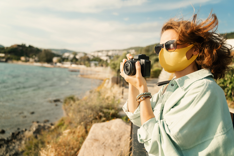 a woman taking a photo on a best road trip