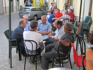 men at a table playing cards in Accettura, the ancestral of my family in Italy