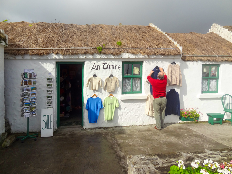 A man in a red sweater at a shop on the Aran Island, Ireland