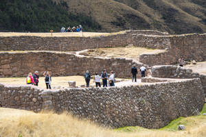 people inside the remains of an old fortress seen in Cusco and the Sacred Valley in Peru