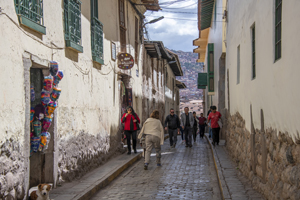 people walking down an ancient street seen in Cusco and the Sacred Valley in Peru