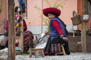 a woman in a large hat seen in Cusco and the Sacred Valley in Peru