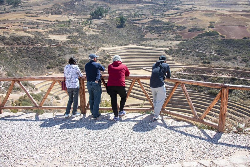 people looking at large terraces seen in Cusco and the Sacred Valley in Peru