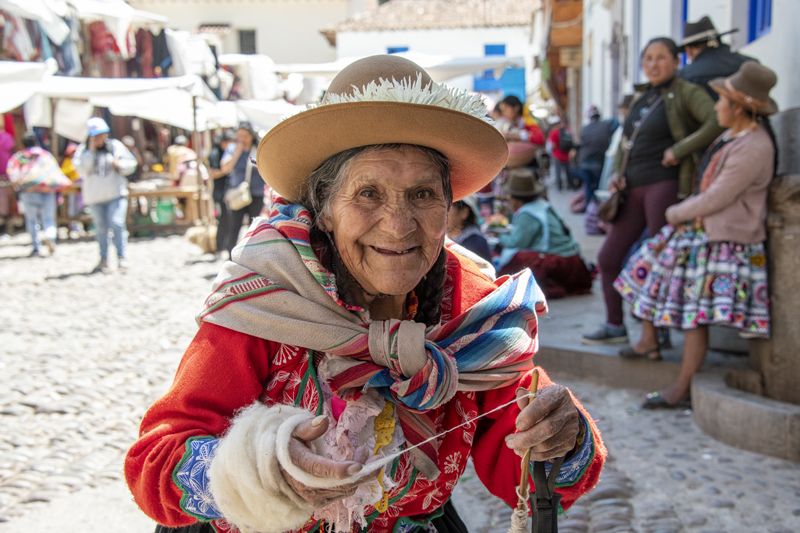 a woman in red seen in seen in Cusco and the Sacred Valley in Peru